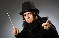 Stock Photo of Funny magician wearing cylinder hat