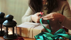 Women's Hands Wrapping Christmas Gifts At Home Stock Footage
