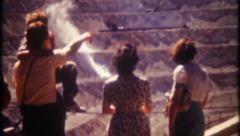 2645 - open pit mine, tourist, dynamite explosions - vintage film home movie Stock Footage