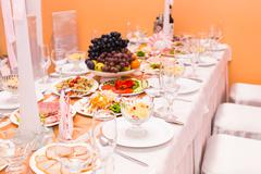 Christmas And New Year Holiday Table Setting. Celebration. Place setting for - stock photo