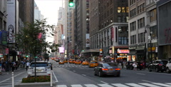 Establishing shot in Manhattan 3rd Avenue, sky scarpers and cars - stock footage