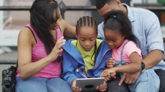 4K Happy African American family in the city looking at computer tablet.  - stock footage