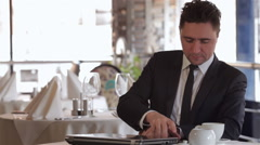 A man receives a call at lunchtime Stock Footage