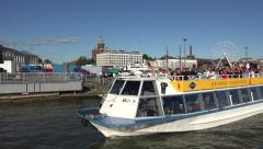 A Gray Line sightseeing tour boat (in 4k) in Helsinki harbour, Finland. Stock Footage