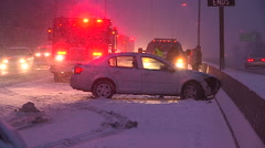 Car accident scene in blizzard and snowstorm with police fire ambulance Stock Footage