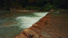 Small Waterfall in a River Ultra Wide View Stock Footage