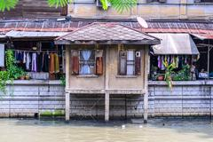 Urban ghetto house village canal side in Bangkok Thailand. Kuvituskuvat