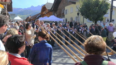 The Désalpes in Charmey, Switzerland. Alpine horn band Stock Footage
