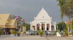 People walking around Wat Supatnaram Worawihan,Ubon Ratchathani,Thailand Stock Footage