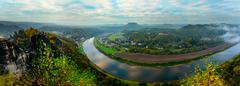 View from viewpoint of Bastei in Saxon Switzerland Germany to the town city a - stock photo