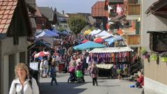 The Désalpes in Charmey, Switzerland. Village market wide shot Stock Footage