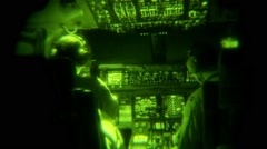 Night Vision shot inside the cockpit of a military cargo plane Stock Footage