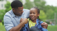 4K Happy African American father & son having fun in the park - stock footage