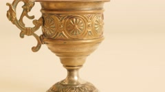 Ancient brass grail on white surface high detailed object 4K 2160p UltraHD ti Stock Footage