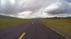 Timelapse Car driving on road of pastoral areas,Qinghai,China - stock footage
