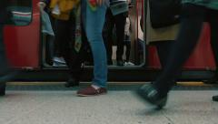 London Tube Low Angle Shot of Passengers Boarding a Train Stock Footage
