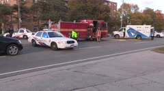 Car accident into transit shelter with police fire and paramedics in Toronto Stock Footage
