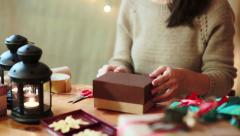 Young Woman Wrapping Christmas Gifts At Home - stock footage