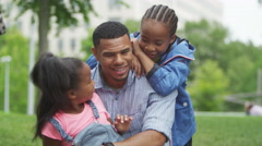 4K Portrait of happy African American father & children having fun in the park - stock footage