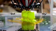 3D printer prints two figures Stock Footage