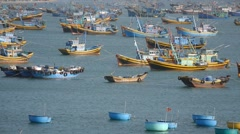 Beautiful view on blue sea and fishing boats.  Vietnamese lifestyle. Pan shot - stock footage
