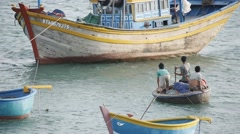Fishermen on boat floating and preparing for sailing. Vietnamese lifestyle - stock footage