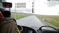 Driving a bus on a country road , Qinghai province, China Stock Footage