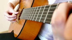 Playing On An Acoustic Guitar - stock footage
