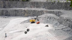 Machines in a granite quarry Stock Footage