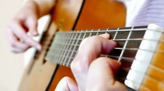 Playing On An Acoustic Guitar Stock Footage