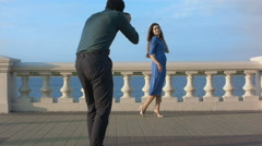 Professional male photographer takes pictures of a model - stock footage
