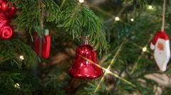 Christmas tree, branch, elegant ornaments, jingle bell, Santa, magic lights Stock Footage