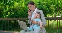 Balancing Business and Motherhood Stock Footage