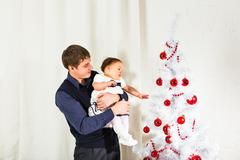 family, children, christmas, x-mas, love concept - happy father with  baby - stock photo