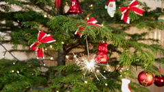 Christmas decorations, tree, burning sparkler, fireworks Stock Footage