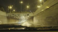 4K driving pov,downtown Athens avenues, night,rain,entering a tunnel. Stock Footage