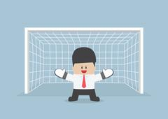 Businessman playing goalkeeper standing in front of goal ready to block the b - stock illustration