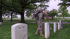 Stock Video Footage of Verginia USA, May 2015, US Soldiers Place US Falg Over Grave
