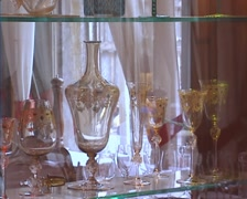 Gold plated Venetian glass on windowsill Stock Footage