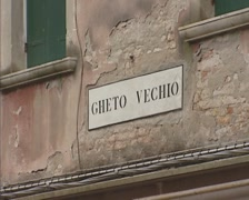 Nameplate Gheto Vechio (Ghetto Vecchio) on the facade of a terraced house Stock Footage