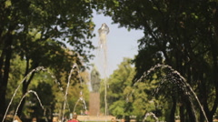 Summer day in crowded park. People strolling, enjoying active weekend leisure Stock Footage
