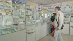Customers visiting russian pharmacy drugstore Stock Footage