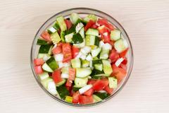 Vegetable salad with onion, tomato and cucumber Stock Photos