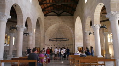 Tourists inside Church of the Multiplication, Israel - stock footage