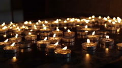Many candles in church, close up Stock Footage