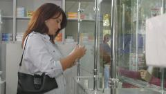 Pharmacist assistant advising customer at russian pharmacy drugstore Stock Footage