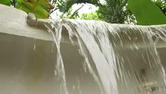 Slow motion low angle of lip of manmade waterfall. Stock Footage
