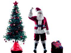 santa claus christmas tree silhouette isolated - stock photo