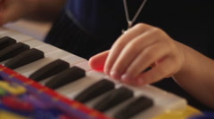 Hand of a child playing keys - stock footage