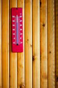 Stock Photo of Thermometer heat on wood background